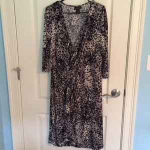 Animal print dress with mock wrap style.